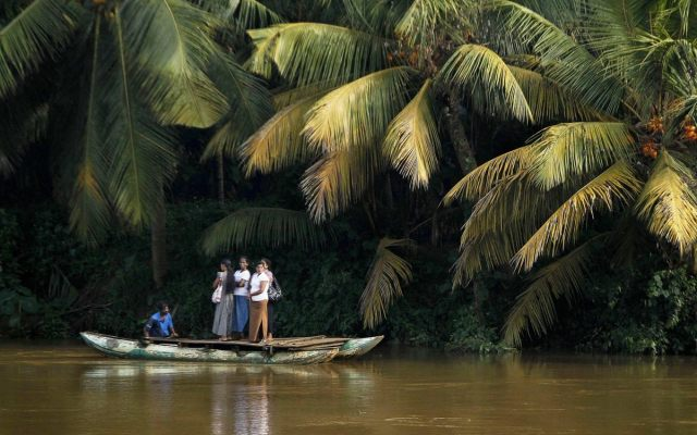 Sri Lankan women stand on a boat as they cross the Kelani river, in Colombo, Sri Lanka, Friday, Oct. 28, 2011. (Eranga Jayawardena/AP)